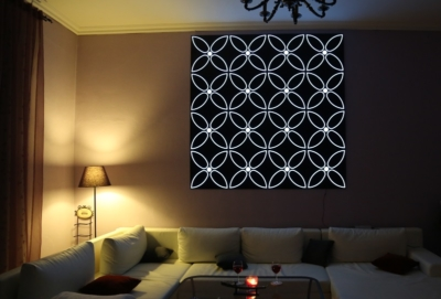 Image by Luminous Concepts showing installation of Lighting Wall paper in living room