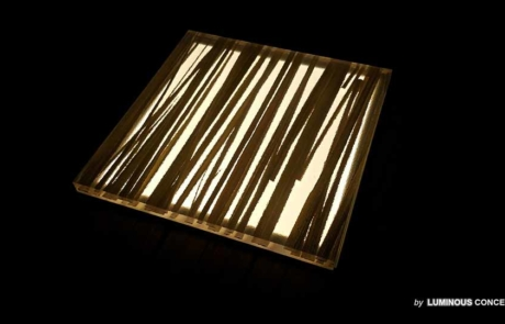 Image of translucent milky plate with integrated weed grass illuminated by Luminous Concepts