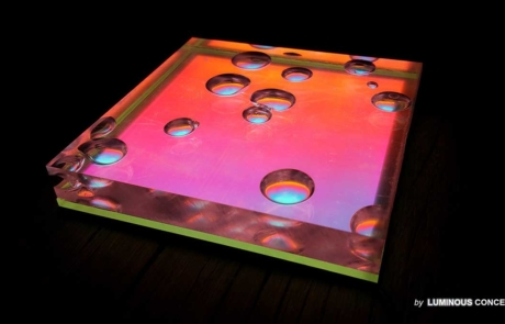Image of optical plastics with bubbles by Luminous Concepts