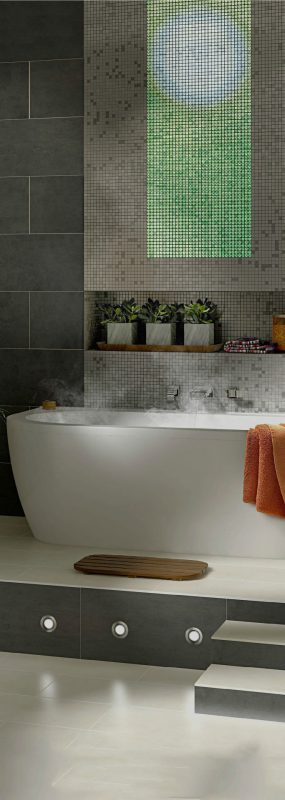 Image of a bathroom environment with green lighting volatiles mosaic tiles installed in an elegant smart line above the bath tub